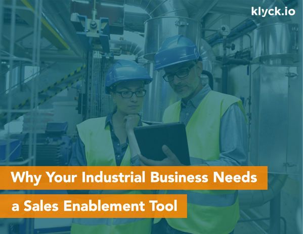 Industrial sales reps using sales enablement software on mobile device