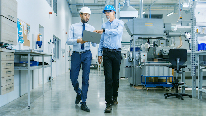 Industrial automation sales rep with a customer
